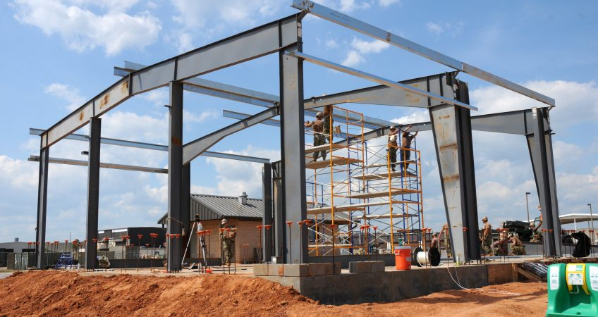 A pre-engineered metal building under construction
