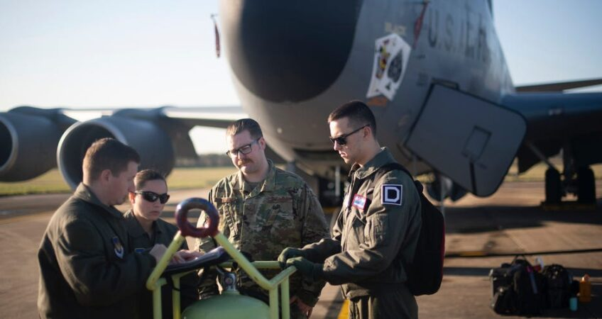Airmen from the 351st Air Refueling Squadron and 100th Aircraft Maintenance Squadron review a checklist prior to a flight at RAF Mildenhall, England, December 4, 2019. US Air Force/Tech. Sgt. Emerson Nuñez